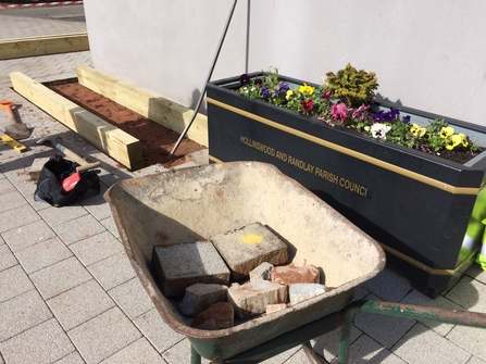 DePave: paving stones removed for raised beds at Hollinswood Neighbourhood Centre