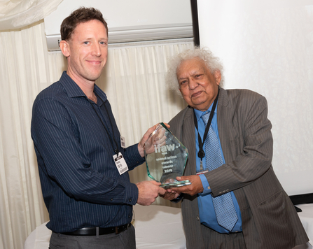 Stuart receiving award